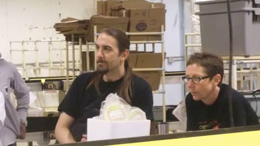Mike Sarowski and Betty Gratopp help manage mail order packages for Zingerman's, a delicatessen and food business in Ann Arbor, Mich. Both earn more than the federal minimum wage of $7.25.