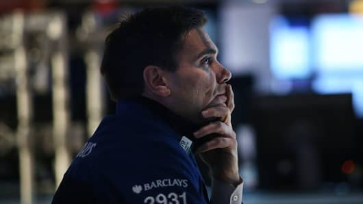 A trader works on the floor of the New York Stock Exchange.
