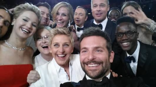 Ellen takes this selfie with fellow celebrities at the Academy Awards 2014.