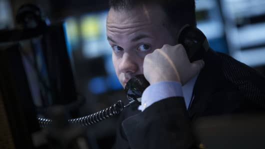A trader speaks on the phone on the floor of the New York Stock Exchange (NYSE) in New York.