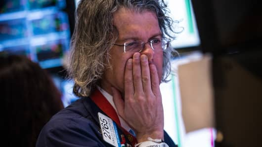 A trader works on the floor of the New York Stock Exchange on the morning of March 3, 2014 in New York City.