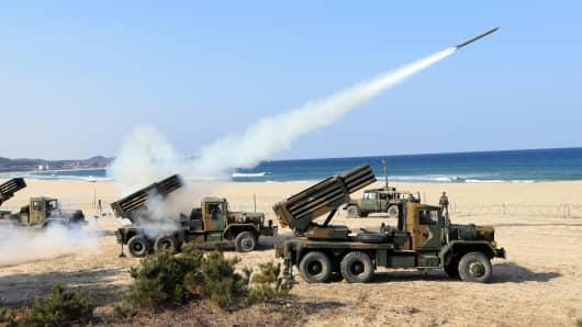 South Korean Army's 130mm multiple rocket launchers fire live rounds during an exercise against possible attacks from North Korea in Goseong, South Korea, Monday, March 3, 2014. North Korea fired two additional suspected short-range missiles into the sea Monday amid ongoing military exercises between Seoul and Washington, which the North calls a preparation for an attack, South Korean officials said.