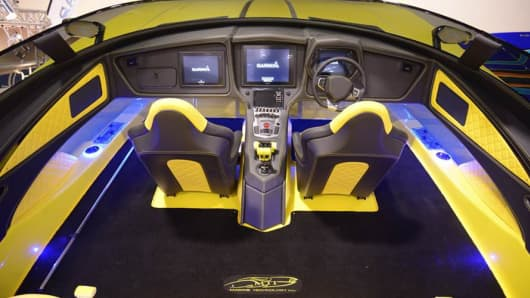 "Detail of the inside of Marine Technology's Aventador boat, which is modeled after a Lamborghini, down to the iconic ""start"" button hidden under a small red lid."