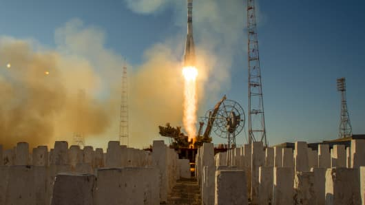 A Soyuz rocket is launched with Russian Commander Mikhail Tyurin and flight engineers Rick Mastracchio of NASA and Koichi Wakata of Japan on Nov. 7, 2013.