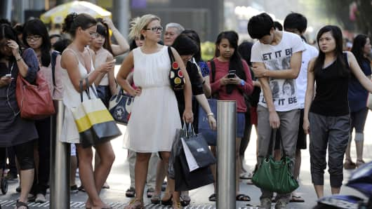 Pedestrians at Orchard Road, Singapore's iconic shopping belt