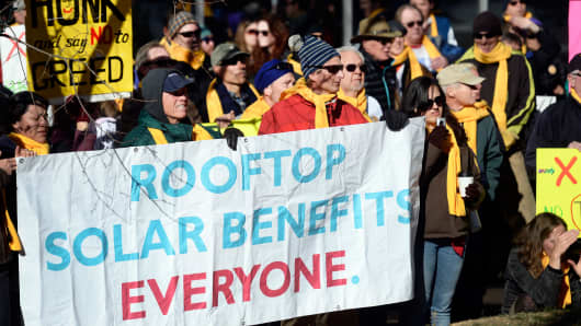 More than a 100 people gathered December 11, 2013 to protest Xcel's plan to stop paying people with solar panels.
