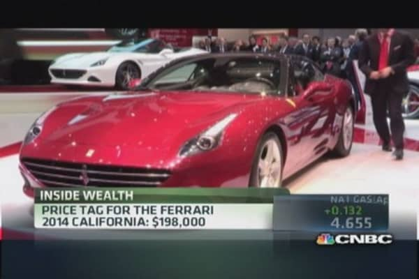 Ferrari profits from selling less
