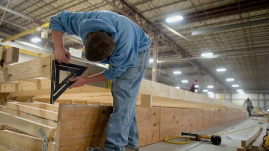 Workers build the modular home units inside Westchester Modular Homes' one hundred and ten thousand square foot factory in Wingdale, NY.