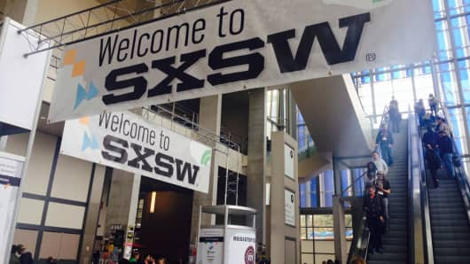 People arrive at the 2014 SXSW conference in Austin, Texas.