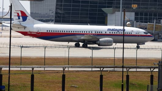 Malaysia Airline passenger jet parked on the tarmac at the Kuala Lumpur International Airport.