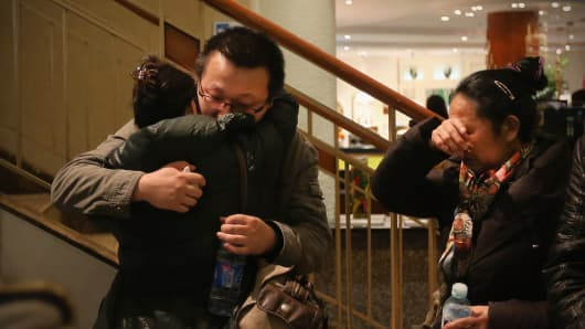 Relatives of a passenger onboard Malaysia Airlines flight MH370 at the Lido Hotel where families are gathered on March 9, 2014 in Beijing, China.
