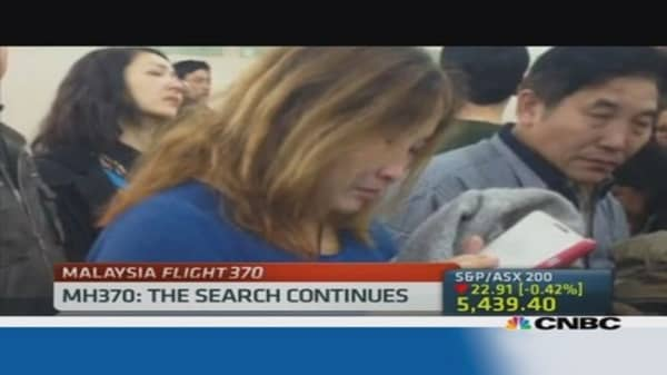 Distraught families await news of missing flight 370