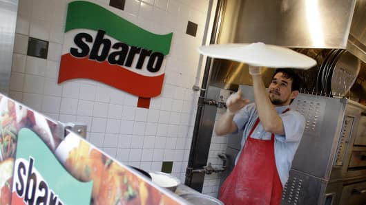 Sbarro Inc., the pizza chain owned by buyout firm MidOcean Partners, filed for bankruptcy protection after missing interest payments on its debt.