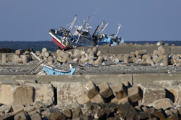 A fishing vessel swept ashore by the tsunami following the March 2011 earthquake sits abandoned on a breakwater in Namie, Fukushima Prefecture, Japan, on Monday, March 10, 2014.