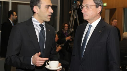 Cyprus Finance Minister Harris Georgiades (L) speaks with the European Central Bank President Mario Draghi (R)