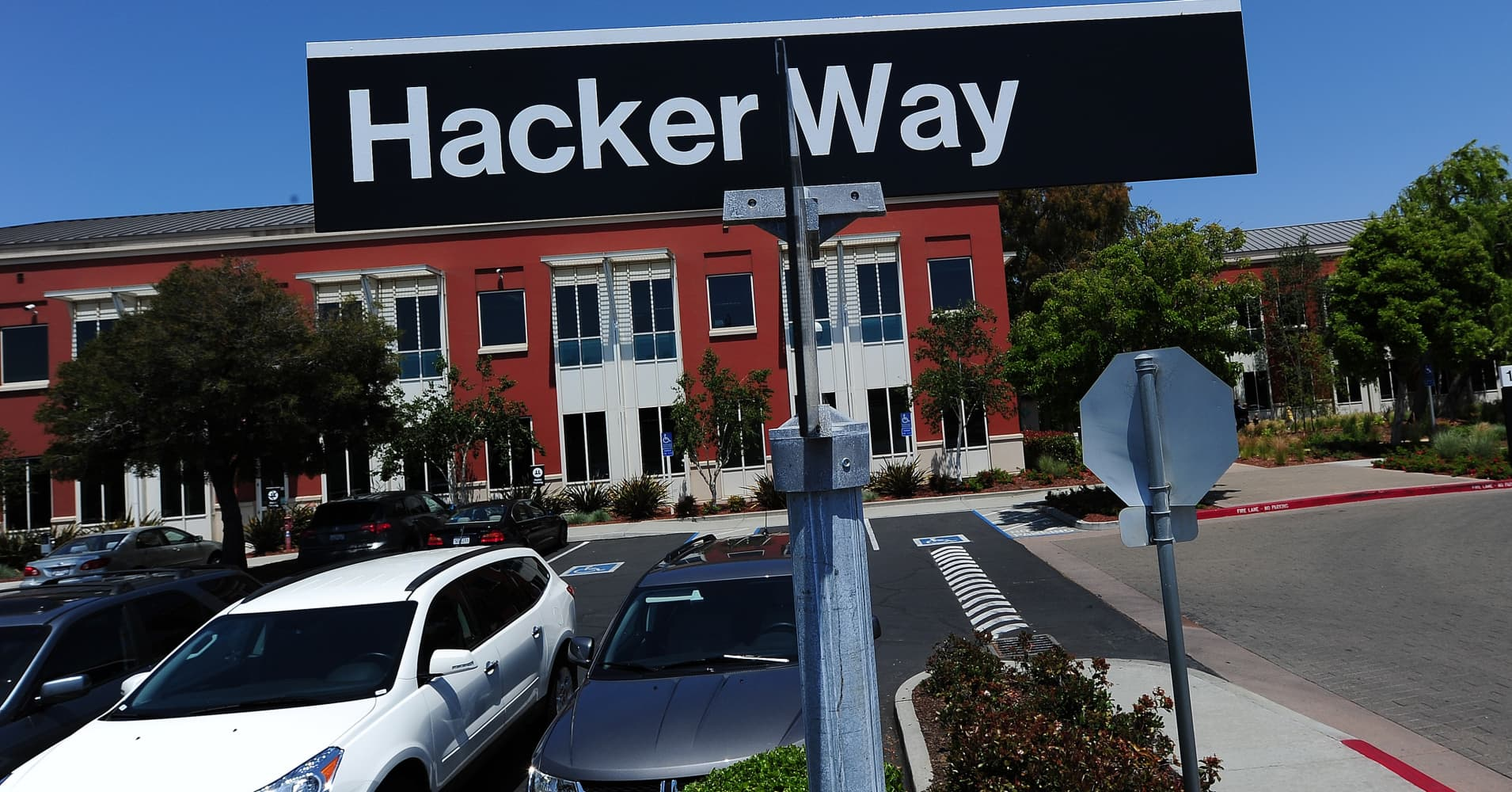 street sign reading 'Hacker Way' is seen in the parking lot of the Facebook headquarters in Menlo Park, California.