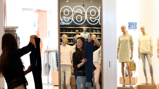An employee folds clothes at a Gap store on February 20, 2014 in San Francisco, California.