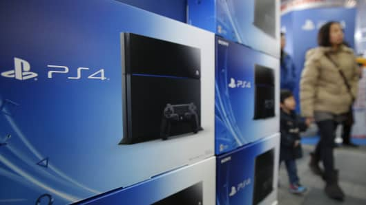 Boxes sit on display for Sony Computer Entertainment Inc.'s PlayStation 4 video game console at a Bic Camera Inc. electronics store.