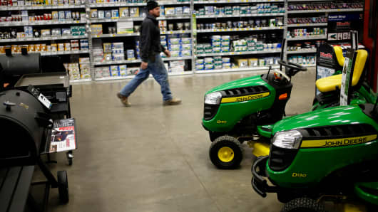 A customer walks past barbecue grills and John Deere lawn mowers at a Lowe's Cos. store in Louisville, Kentucky, Feb. 24, 2014.
