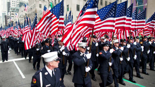 Members of FDNY march on Fifth Avenue during the St. Patrick's Day Parade in New York City.