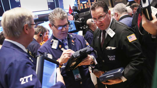 Traders work the floor of the New York Stock Exchange after the opening bell on March 14, 2014 in New York City.