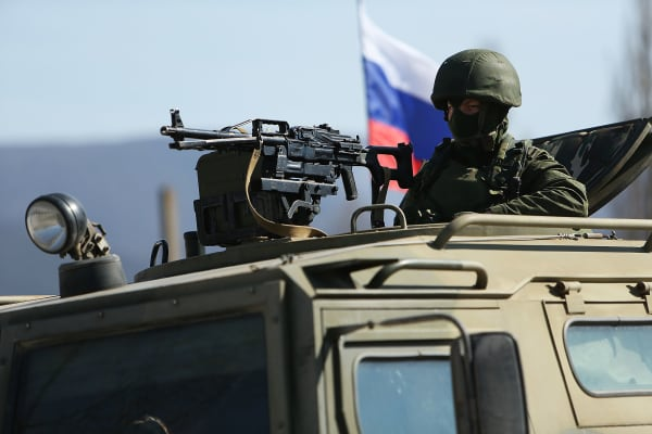 Russian paramilitaries stand guard outside of a Ukrainian military base in the town of Perevevalne near the Crimean city of Simferopol on March 11, 2014 in Perevevalne, Ukraine.
