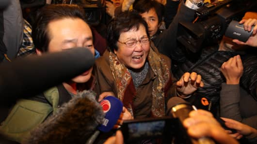 A relative of a passenger onboard Malaysia Airlines flight MH370 cries at Lidu Hotel in Beijing, China.