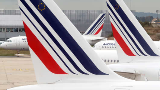 Air France planes are parked on the tarmac of Roissy Charles-de-Gaulle airport.