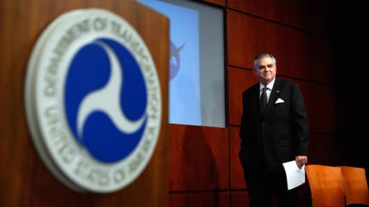 Transportation Secretary Ray LaHood arrives for a news conference where he announced findings from a 10-month-long National Highway Traffic Safety Administration study into unintended acceleration in Toyota vehicles at the Transportation Department on Feb. 8, 2011.