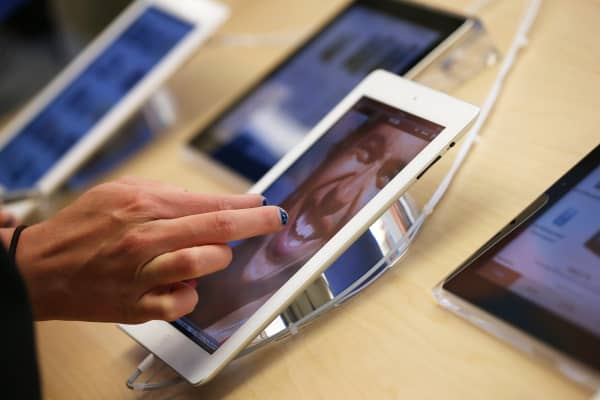 A customer inspects a fourth-generation iPad at an Apple store in San Francisco.