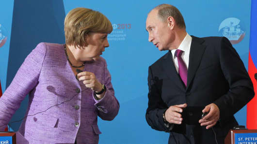 German Chancellor Angela Merkel and Russian President Vladimir Putin attend a press conference during the Saint Petersburg International Economic Forum in June 2013.