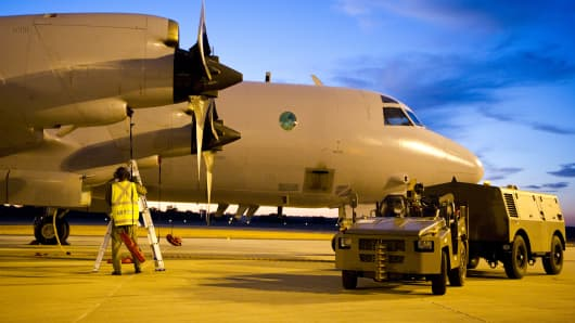 In this photo provided by the Australian Defence Department, a Royal Australian Air Force AP-3C Orion aircraft has post-flight checks.