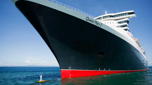 Capt. Kevin Oprey on underwater bow of Cunard Line's Queen Mary 2