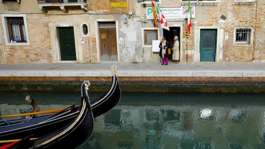 Voters leave a polling station after having casted their vote in Venice, Italy