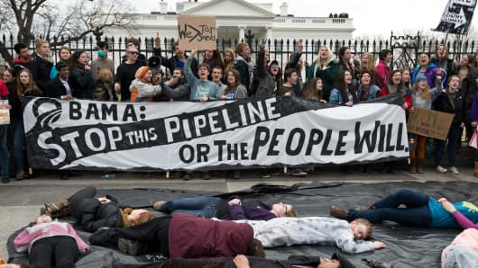 Students protest against the proposed Keystone XL pipeline on March 2, 2014.