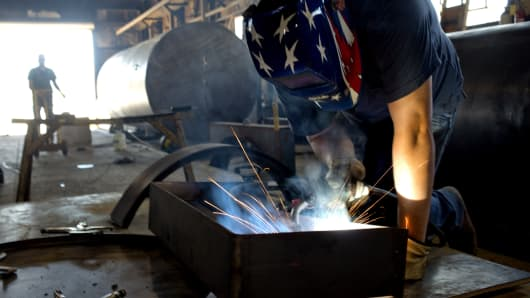A welder builds parts for finished petroleum tanks at Southern Tank and Manufacturing Inc. in Owensboro, Kentucky.