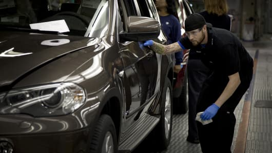 A worker inspects the body of a vehicle on the production line at the Bayerische Motoren Werke AG (BMW) manufacturing plant in Spartanburg, South Carolina.