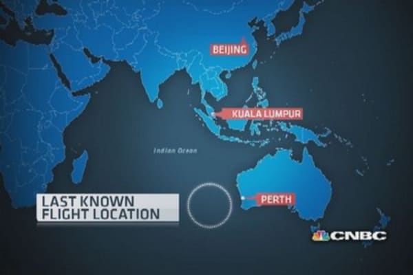 Bad weather halts search for missing Malaysia jet