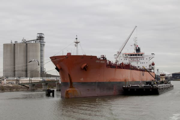 In this file photo, a ship sits docked along the Houston Ship Channel in Houston, Texas. The U.S. Coast Guard are preparing to reopen the channel after an oil spill closed the channel.