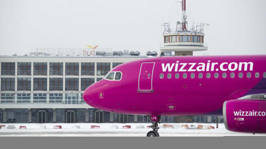 An aircraft in wizzair.com livery taxis on the tarmac at Liszt Ferenc airport in Budapest, Hungary.