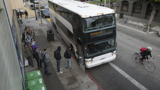 Google employees board a bus in San Francisco for the company's campus in Mountain View.