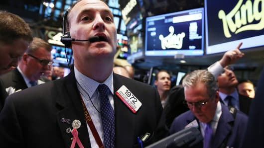 Traders work on the floor of the New York Stock Exchange on March 26, 2014.