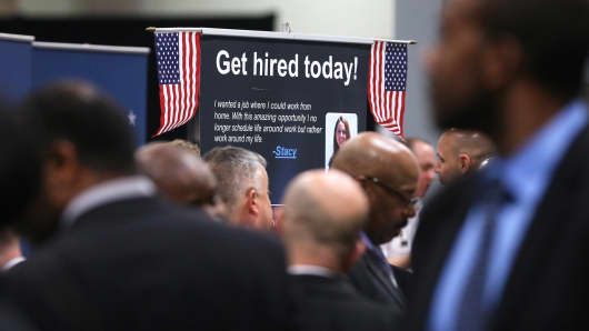 People visit booths of prospective employers during the Hiring Our Heroes job fair at the Washington Convention Center, on January 10, 2014 in Washington.