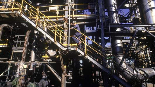 Worker on staircase leading to processing platform at nickel refinery
