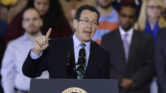 Connecticut Gov. Dannel P. Malloy introduces President Barack Obama before Obama spoke about the minimum wage during an event in Kaiser Hall on the Central Connecticut State University campus in New Britain, Conn., Wednesday, March 5, 2014.