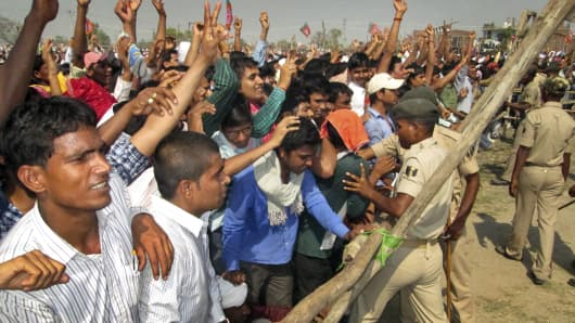 Security personnel control crowd during a rally of BJP PM candidate Narendra Modi for the upcoming Lok Sabha election in Sasaram, India.