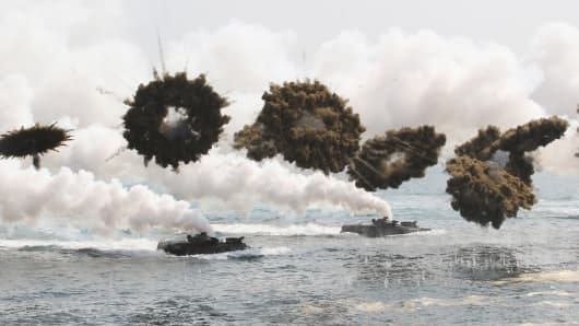 South Korean marine LVT-7 landing craft sail to shores through smoke screens during the U.S.-South Korea joint military exercises called Ssangyong, part of the Foal Eagle military exercises, in Pohang, South Korea, Monday, March 31, 2014.