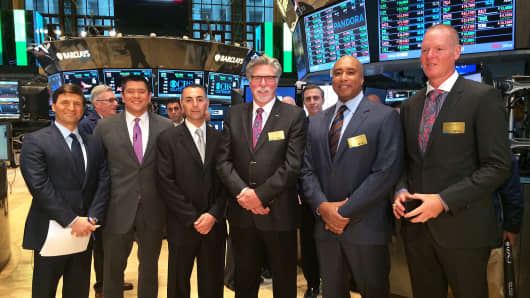 Former Major League Baseball players John Franco, Jack Morris, Bernie Williams and Jeff Nelson pose for a photo with CNBC's David Faber and Carl Quintanilla after ringing the opening bell at the New York Stock Exchange, March 31, 2014. The ballplayers advocated for making the MLB's Opening Day a national holiday in the United States.