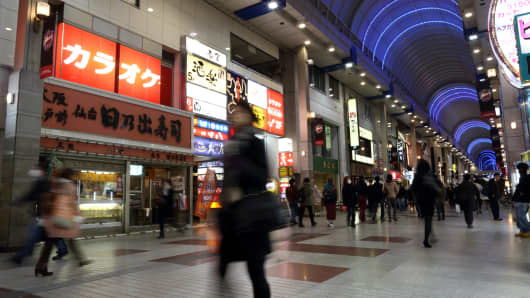 Pedestrians walk through a shopping street in Sendai, Miyagi Prefecture, Japan.
