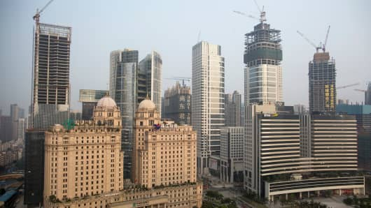 High-rise construction projects in the Zhujiang New Town district of Guangzhou, Guangdong Province, China, March 26, 2014.
